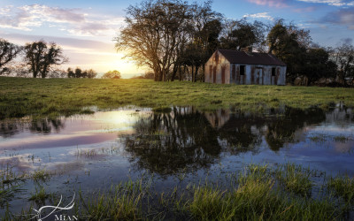 A wriggly tin house in a flooded field at sunset in Knocktemple, Virginia, Co. Cavan, Ireland